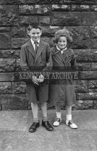 6th May 1957; A boy and a girl pose for the camera on confirmation day in Dingle.