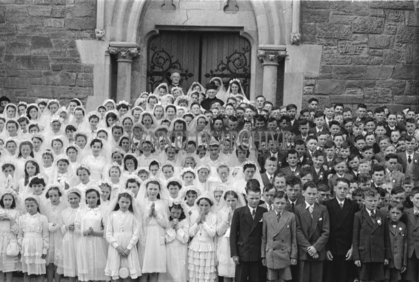 6th May 1957; The confirmation children pose for the camera with Bishop Moynihan and Canon Lyne in Dingle.