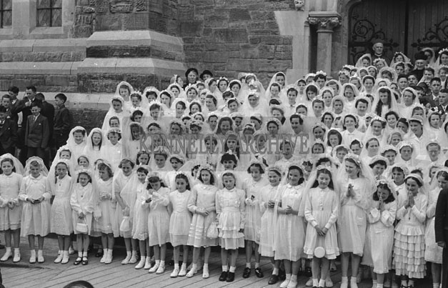 6th May 1957; The confirmation girls pose for the camera with Bishop Moynihan and Canon Lyne in Dingle.