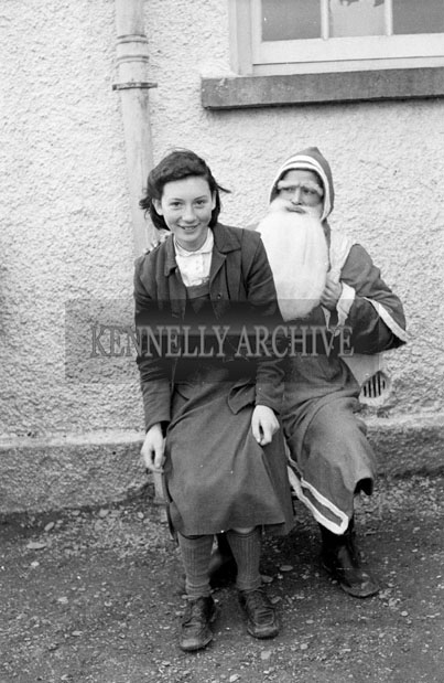 December 1957; A photo taken with Santa at St. Ita's National School.