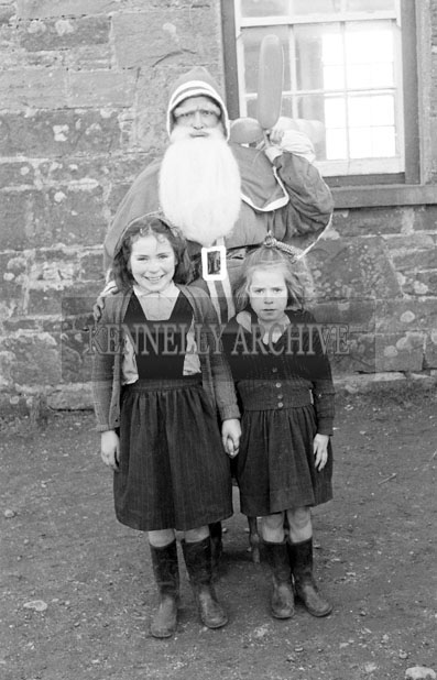 December 1957; A photo taken with Santa at Castledrum National School.