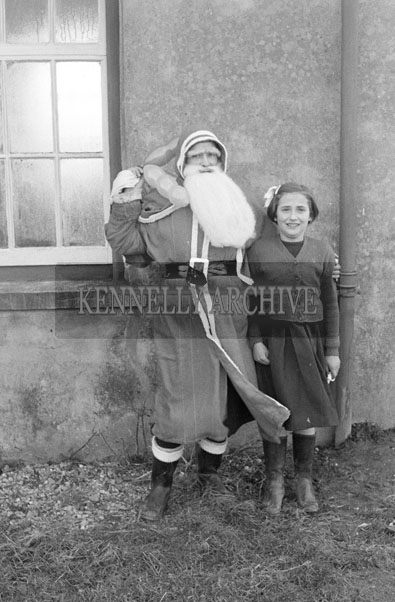 December 1957; A photo taken with Santa at a National School near Castlemaine.