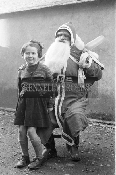 December 1957; A photo taken with Santa at Kiltallagh National School.