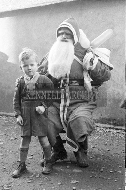 December 1957; A photo taken with Santa at Kiltallagh National School.