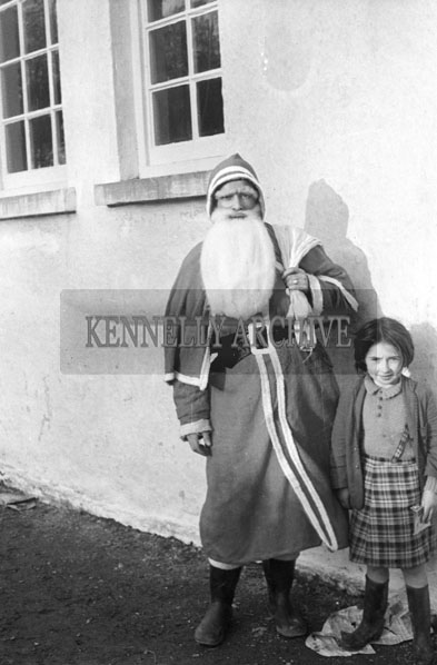 December 1957; A photo taken with Santa at Callinafercy National School.