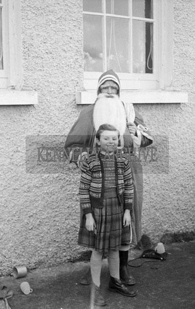 December 1957; A photo taken with Santa at Curaheen National School.