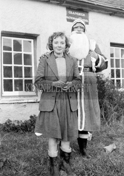 December 1957; A photo taken with Santa at Glenbeigh National School.