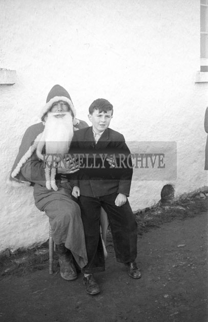 December 1957; A photo taken with Santa at Faha National School.