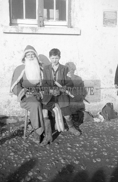 December 1957; A photo taken with Santa at Drumcurra National School.
