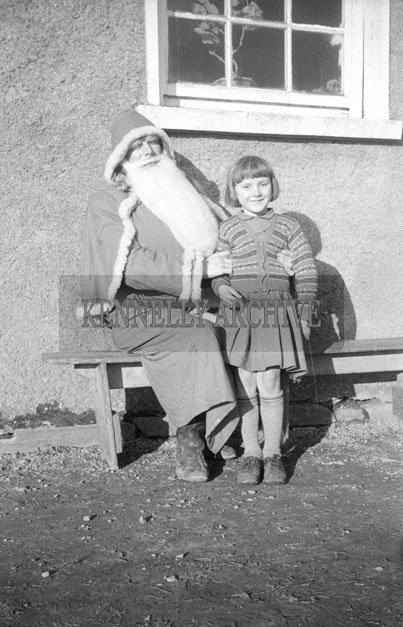 December 1957; A photo taken with Santa at Bouleenshere National School.