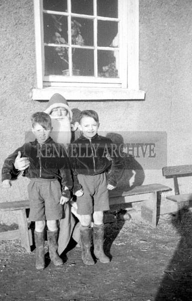 December 1957; A photo taken with Santa at Bouleenshere National School.