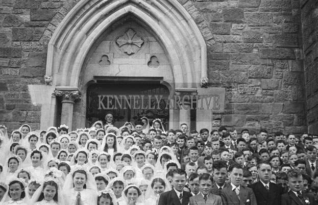 6th May 1957; The confirmation children pose for the camera with Most Reverend Bishop Moynihan and the Very Reverend Canon Lyne in Dingle.