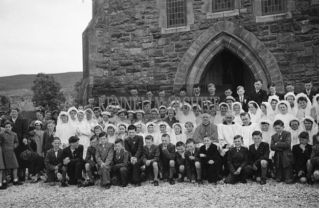 6th May 1957; The confirmation children pose for the camera with Most Reverend Bishop Moynihan in Annascaul.