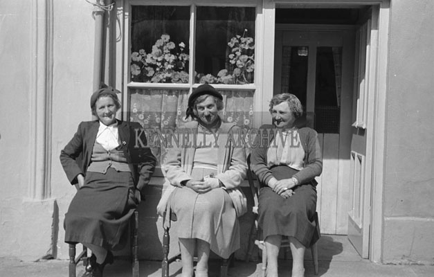 May 1957; Three women pose for a photo in Abbeyfeale.