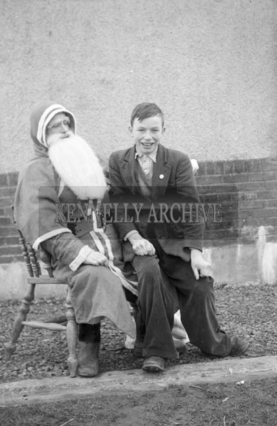 December 1957; A photo taken with Santa at St. Declan's National School.