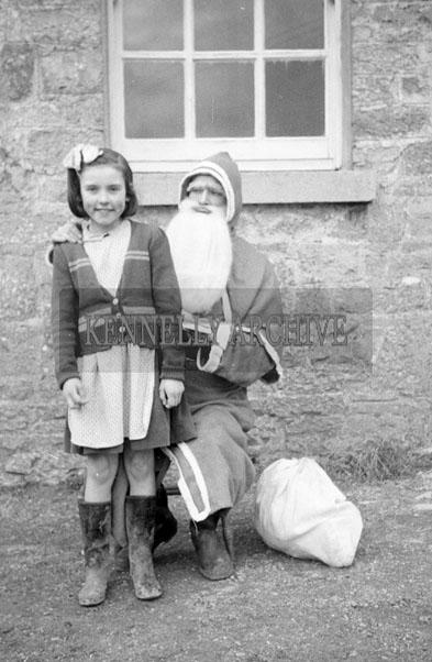 December 1957; A photo taken with Santa at Banna National School.