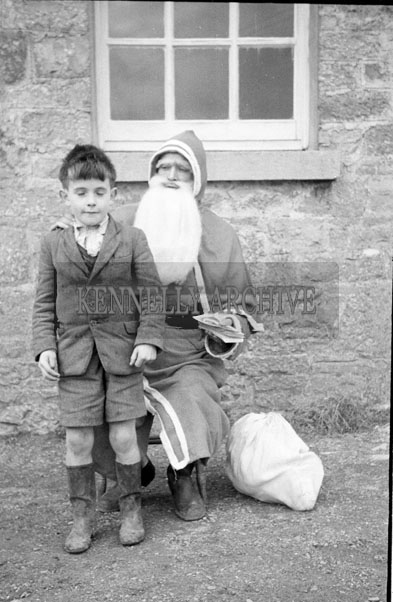 December 1957; A photo taken with Santa at Banna National School.