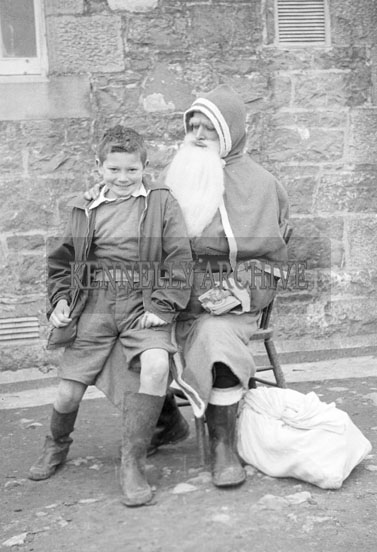 December 1957; A photo taken with Santa at Tubrid National School.