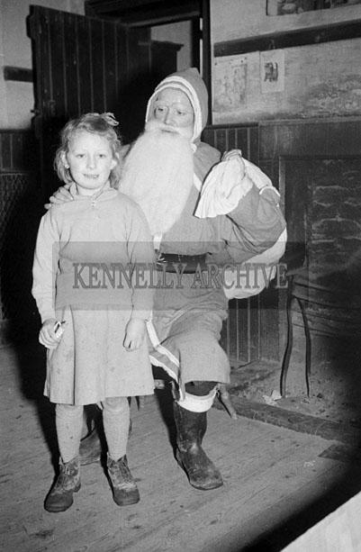 December 1957; A photo taken with Santa at Ardglas National School.