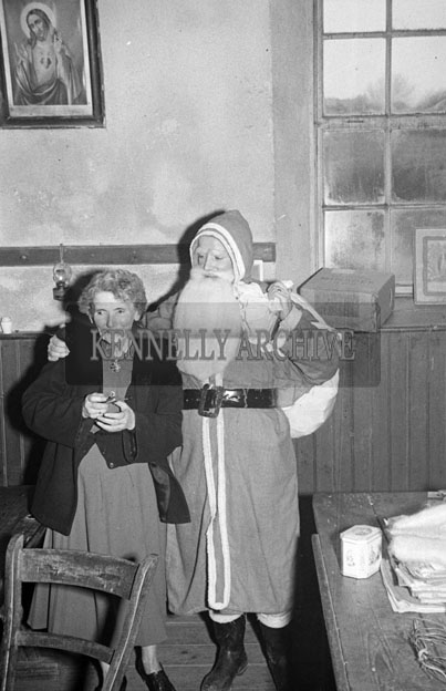 December 1957; A photo taken with Santa at Ardglas National School.