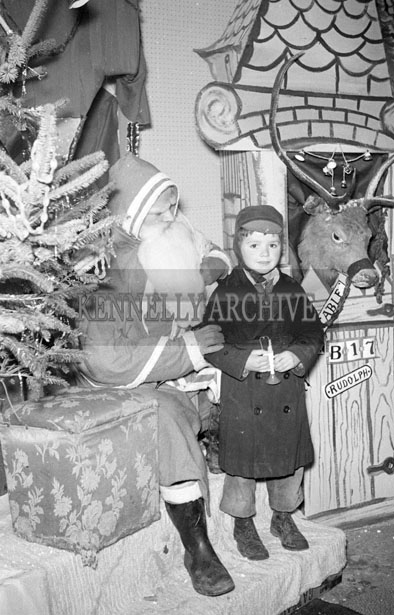 December 1957; A photo taken with Santa in Foley's Shop, Castle Street, Tralee.