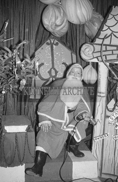 December 1957; A photo taken with Santa in Foley's Shop, Castle Street, Tralee.