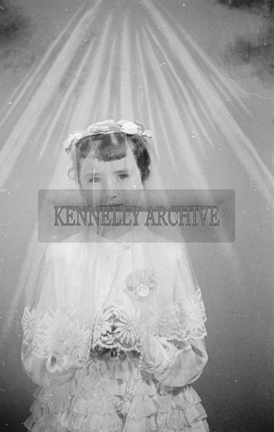 May 1957; A studio photo of a First Communion girl.