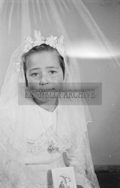 May 1957; A communion photo of Miss Scollard, Scartaglin, taken in the studio.