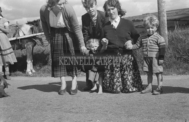 May 1957; A photo of traveller women and children.