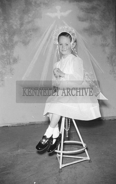 May 1957; A photo of Miss Carroll, Ardfert, taken in the studio on her First Holy Communion.
