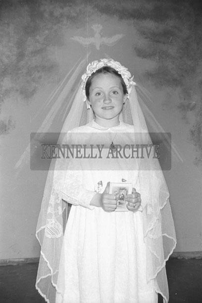 June 1957; A studio photo of a communion girl.