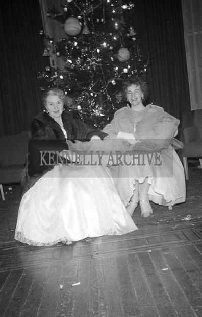 27th December 1957; Two women photographed at Tralee Rugby Club Dress Dance in The Great Southern Hotel, Killarney.