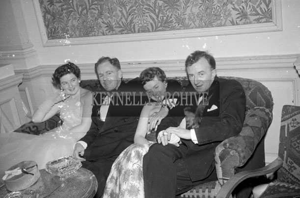 27th December 1957; Derry O'Rourke (right) and a group enjoying themselves at the Tralee Rugby Club Dress Dance in The Great Southern Hotel, Killarney.