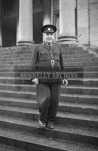 December 1957; A photo of a retiring Garda on the steps of the Courthouse in Ashe Street, Tralee.
