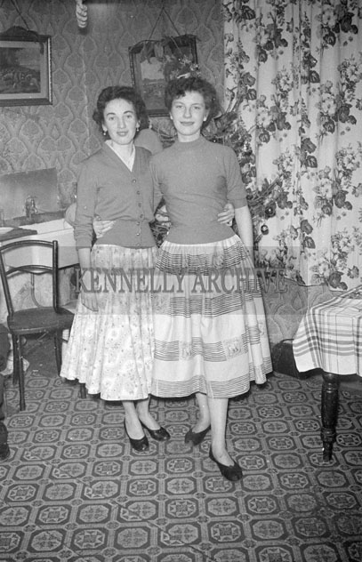 December 1957; Women posing for the camera at the Griffin party in Mitchels Avenue, Tralee.