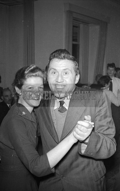 December 1957; An accordion player at a teenage dance.