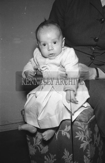 June 1957; A studio photo of a baby.