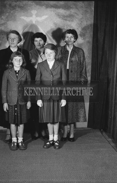 June 1957; A studio Confirmation photo of Miss O'Rourke and her family.