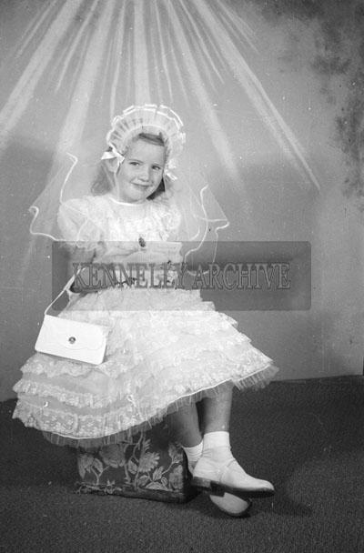 June 1957; A studio communion photo of the O'Halloran girl, Ballyheigue.