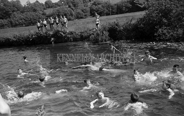 June 1957; A group of Irish students swimming near Ballingeary Irish College.