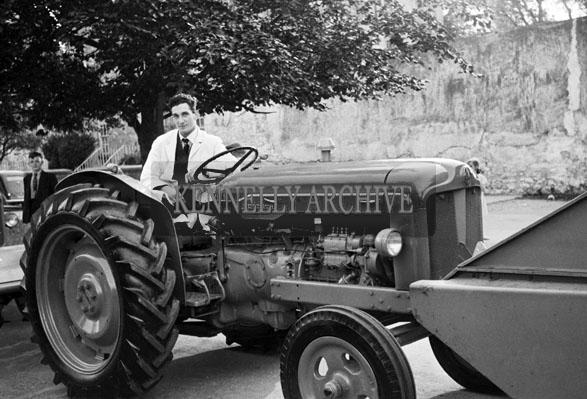 18th June 1957; A photo of a tractor in the Tralee Trade Show Parade in Princes Street during the Kingdom County Fair.