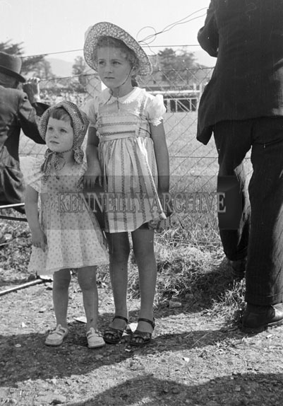 19th June 1957; Two girls at the Kindom County Fair Ballymullen, Tralee.