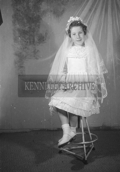 June 1957; A studio photo of a communion girl.