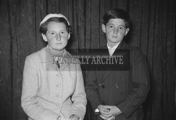 June 1957; A studio confirmation photo of a girl and boy.