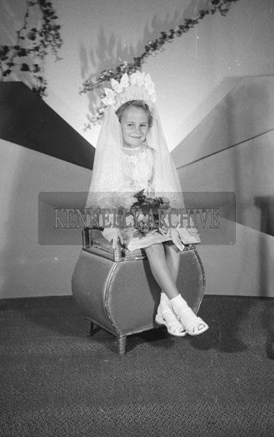 June 1957; A studio communion photo of Ann O'Brien.