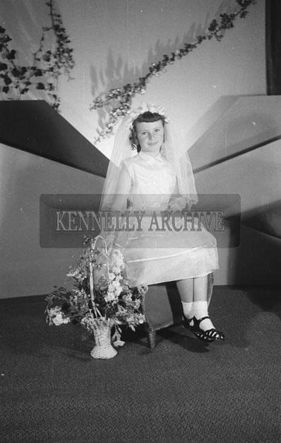 June 1957; A studio communion photo of Ann Ryan.