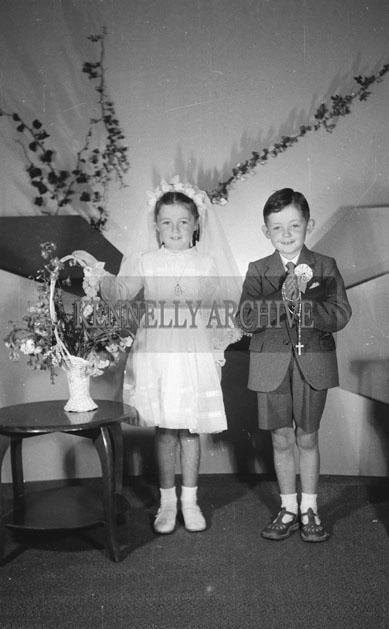 June 1957; A studio Communion photo of Martha and Michael Regan.
