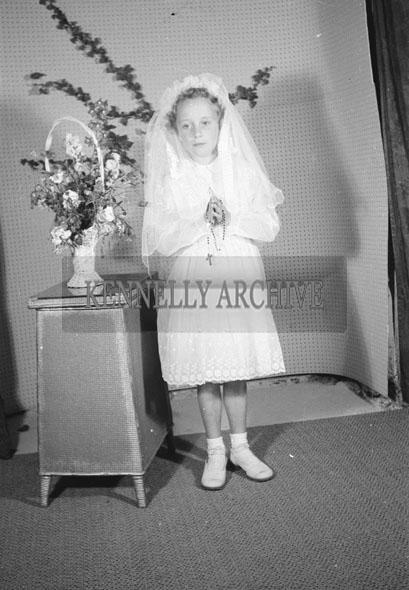 June 1957; A studio Communion photo of Catherine O'Brien.