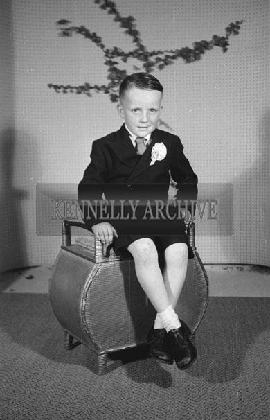 June 1957; A studio Communion photo of Michael Griffin.