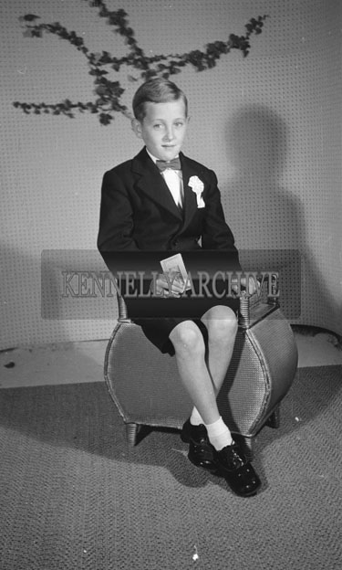 June 1957; A studio Communion photo of Frank Roche.